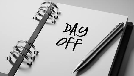 remind: Closeup of a personal agenda setting an important date writing with pen. The words Day off written on a white notebook to remind you an important appointment.