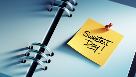sweetest: Closeup Yellow Sticky Note paste it in a notebook setting an appointment. The words Sweetest Day written on a white notebook to remind you an important appointment. Stock Photo