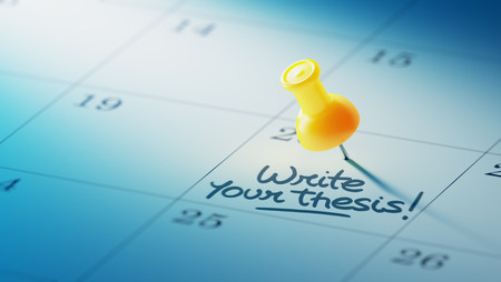 thesis: Concept image of a Calendar with a yellow push pin. Closeup shot of a thumbtack attached. The words Write your thesis written on a white notebook to remind you an important appointment. Stock Photo