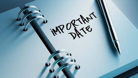 important date: Closeup of a personal agenda setting an important date writing with pen. The words Important date written on a white notebook to remind you an important appointment.