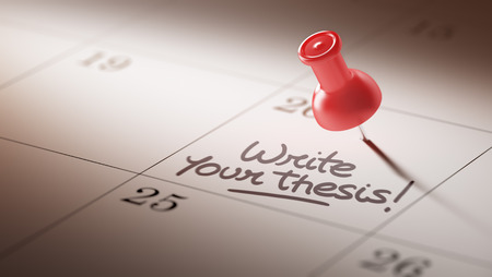 thesis: Concept image of a Calendar with a red push pin. Closeup shot of a thumbtack attached. The words Write your thesis written on a white notebook to remind you an important appointment. Stock Photo