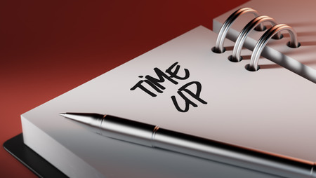 up to date: Closeup of a personal agenda setting an important date writing with pen. The words Time up written on a white notebook to remind you an important appointment. Stock Photo