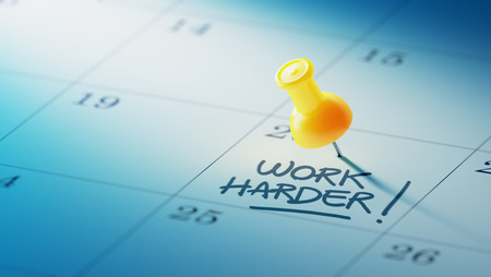 hard day at the office: Concept image of a Calendar with a yellow push pin. Closeup shot of a thumbtack attached. The words Work Harder written on a white notebook to remind you an important appointment. Stock Photo