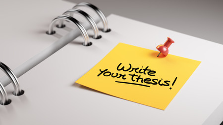 thesis: Closeup Yellow Sticky Note paste it in a notebook setting an appointment. The words Write your thesis written on a white notebook to remind you an important appointment.