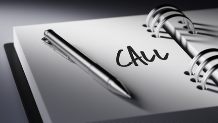personal call: Closeup of a personal agenda setting an important date writing with pen. The words Call written on a white notebook to remind you an important appointment.