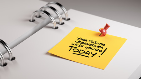 depends: Closeup Yellow Sticky Note paste it in a notebook setting an appointment. The words Your future depends on what you do today written on a white notebook to remind you an appointment. Stock Photo