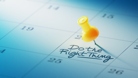 yellow push pin: Concept image of a Calendar with a yellow push pin. Closeup shot of a thumbtack attached. The words Do the right thing written on a white notebook to remind you an important appointment. Stock Photo