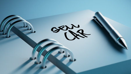 sell car: Closeup of a personal agenda setting an important date writing with pen. The words Sell Car written on a white notebook to remind you an important appointment.