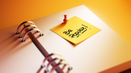 trending: Closeup Yellow Sticky Note paste it in a notebook setting an appointment. The words Be Popular written on a white notebook to remind you an important appointment. Stock Photo