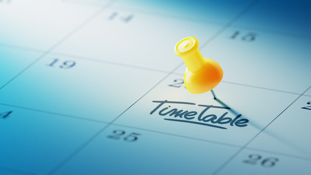 cronologia: Concept image of a Calendar with a yellow push pin. Closeup shot of a thumbtack attached. The words Timetable written on a white notebook to remind you an important appointment.