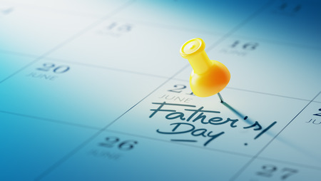 yellow push pin: Concept image of a Calendar with a yellow push pin. Closeup shot of a thumbtack attached. The words Fathers Day written on a white notebook to remind you an important appointment. Stock Photo