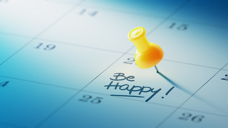 yellow push pin: Concept image of a Calendar with a yellow push pin. Closeup shot of a thumbtack attached. The words Be happy written on a white notebook to remind you an important appointment. Stock Photo
