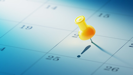 yellow push pin: Concept image of a Calendar with a yellow push pin. Closeup shot of a thumbtack attached. Stock Photo