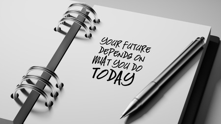 depends: Closeup of a personal agenda setting an important date writing with pen. The words Your future depends on what you do today written on a white notebook to remind you an appointment. Stock Photo