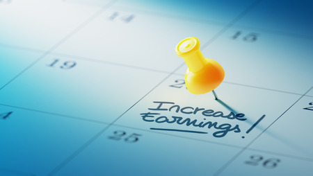 yellow push pin: Concept image of a Calendar with a yellow push pin. Closeup shot of a thumbtack attached. The words Increase Earnings written on a white notebook to remind you an important appointment. Stock Photo