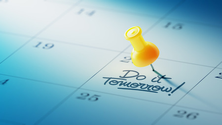 yellow push pin: Concept image of a Calendar with a yellow push pin. Closeup shot of a thumbtack attached. The words Do it Tomorrow written on a white notebook to remind you an important appointment. Stock Photo