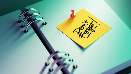 dont: Closeup Yellow Sticky Note paste it in a notebook setting an appointment. The words Don`t Forget written on a white notebook to remind you an important appointment.