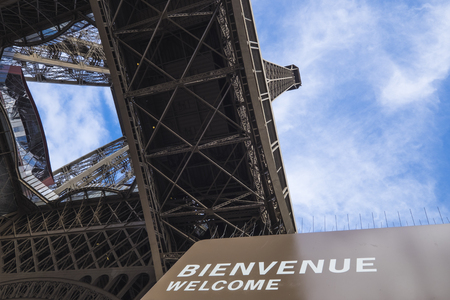 tower: Eiffel Tower welcomes tourists.