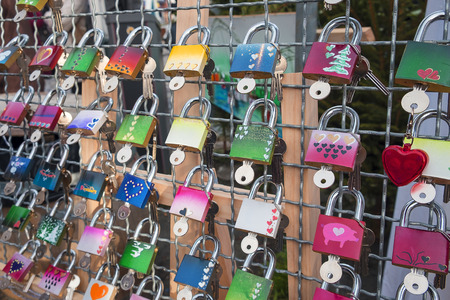 promised: Many many new and colorful love padlocks ready for sale. Stock Photo