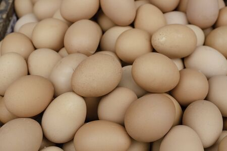 chicken eggs on wooden tray put to sell in the market Standard-Bild