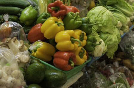 colorful of vegetables on fresh market put for sell for customer like tomato , avocado, chili, cucumber,mushroom etc