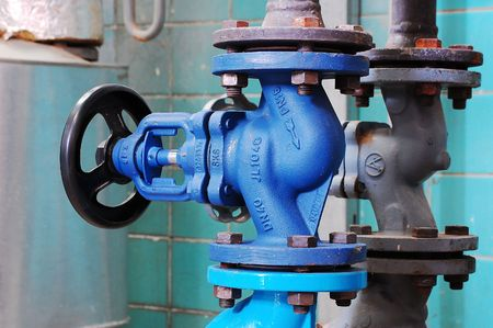 ferrous: Steam pipe with a valve in the boiler room Stock Photo