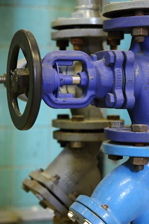 Steam pipe with a valve in the boiler room Stock Photo