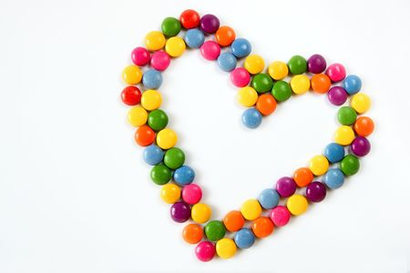 Colorful hearts made from sweets isolated on a white background photo