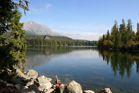 Lake and high Tatras mountains in Slovakia photo