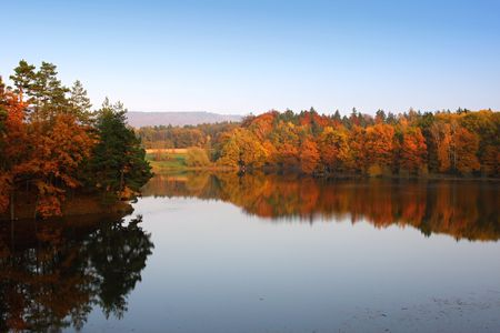 Pond and mirroring in the autumn landscape, Czech Republic