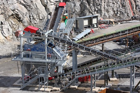 Belt conveyors and mining equipment in a quarry photo