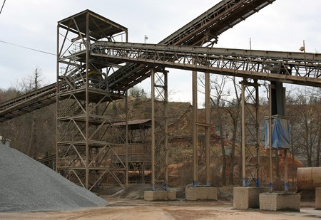 Steel pipes and conveyors at the gravel pit photo