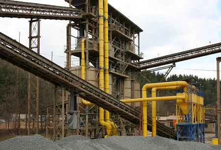 conveyors: Steel pipes and conveyors at the gravel pit Stock Photo