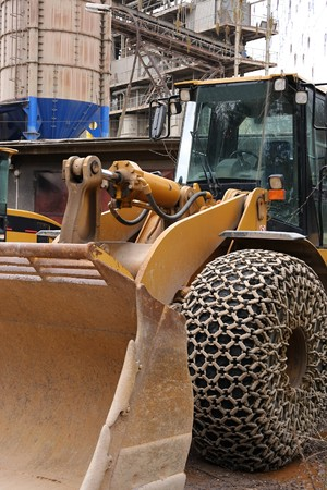 Loader with large wheels and steel chains photo