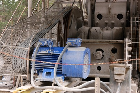 Electric motor with belt drive