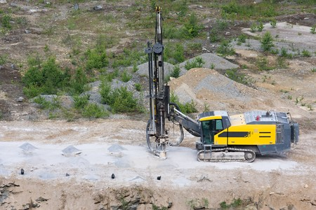 Drilling machine in open cast mining quarry