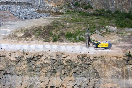 Drilling machine in open cast mining quarry  photo