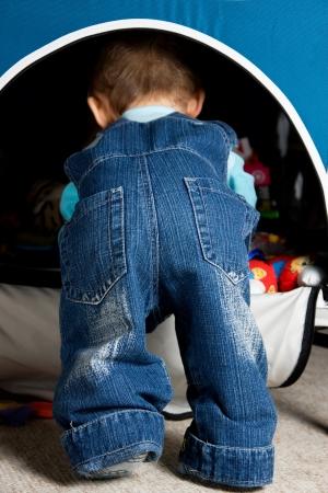 jeans model: Cute baby butt in blue jeans Stock Photo