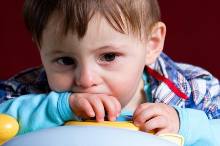 Baby taken close up with sad face