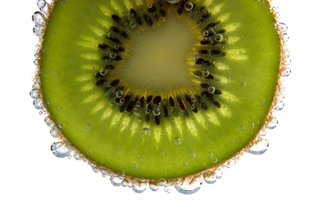 Close-up of a kiwi slice with bubbles  photo