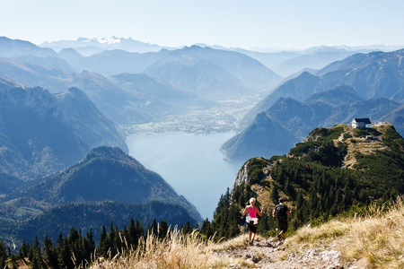 Nordic walking in mountains, Alps and lake Traunsee in Austria photo