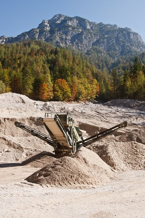 Making of crushed stone at stone quarry photo