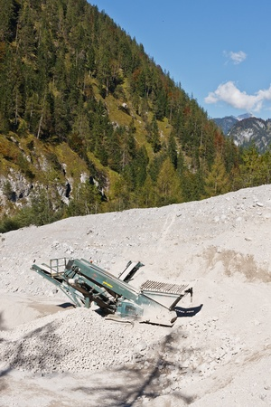 Making of crushed stone at stone quarry, Austria photo