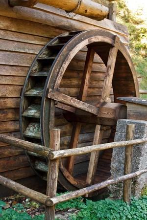 old grist mill: Historic water mill wheel, Austria