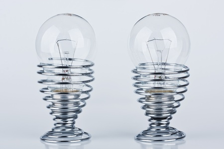 Light bulbs in a modern metal egg cup photo
