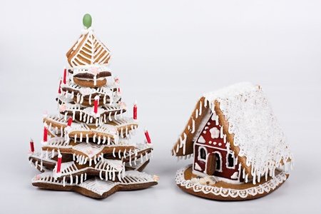 Gingerbread house with gingerbread tree  photo
