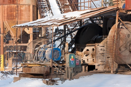 conveyors: Gravel pit, Belt conveyors and electric motor in winter Stock Photo