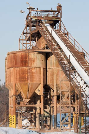conveyors: Belt conveyors and silos in a gravel pit in winter