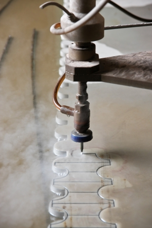 steam jet: Machine using water pressure to cut through stainless steel materials