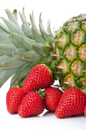 Isolated fruits - Pineapple and Strawberries on white background Stock Photo - 13223285